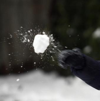 A man from Derby who threw a snowball at a police officer has been charged with assault
