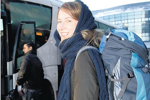 CHRISTMAS FARE: Anne Dunleavy boarding a bus to Donegal at the Busaras in Dublin yesterday