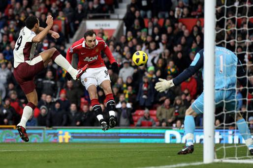 Manchester United's Dimitar Berbatov heads past Sunderland's Craig Gordon to open the scoring at Old Trafford yesterday. Photo: Getty Images