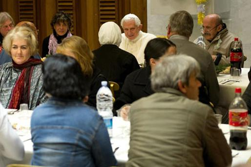 Pope Benedict XVI having lunch with nuns, clergy and 250 poor people inside the Vatican's main audience hall. Photo: L'Osservatore Romano