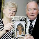 Pictured in 2010 Rose and Jim Callaly hold a photo of their daughter Rachel. Photo: Colin O'Riordan