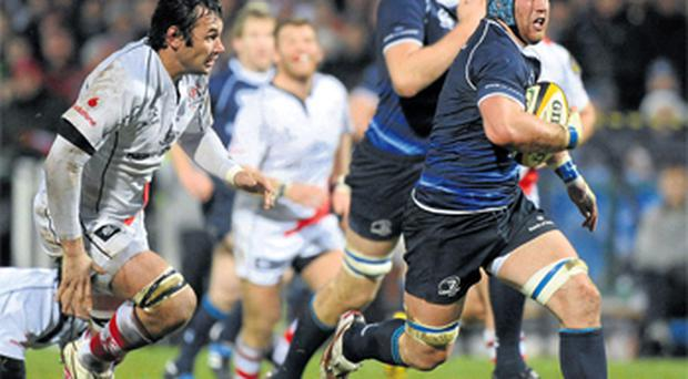 Sean O'Brien races clear of Pedrie Wannenburg on his way to scoring his first try for Leinster at Ravenhill