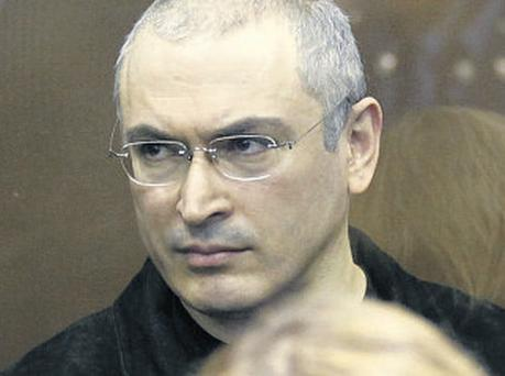 Mikhail Khodorkovsky pictured yesterday in a Moscow court as a judge reads the verdict in his second trial
