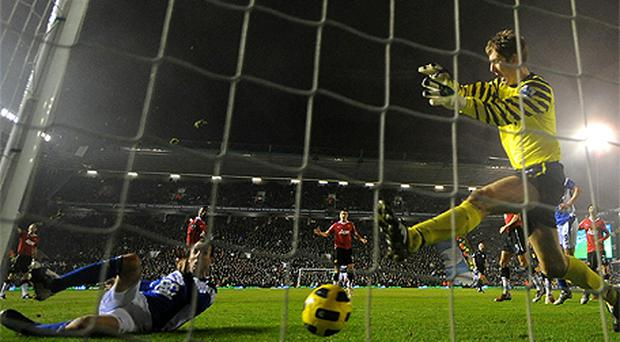 Lee Bowyer stretches to score Birmingham City's late equaliser against Manchester United last night despite the efforts of goalkeeper Edwin van der Sar