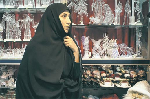 A Christian woman looks at Christmas decorations in central Tehran yesterday