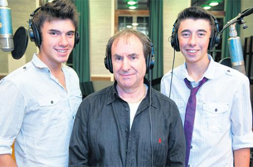 Ben (left) and Jamie Hazelby with singer Chris de Burgh. The brothers have recorded one of de Burgh's songs to raise funds for St Ann's Hospice in Manchester