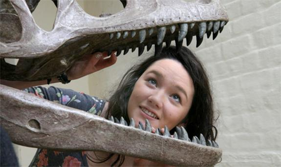 Lucy Mortell (16), from Rathfarnham, gets to grips with one of the dinosaur exhibitions in Dublin yesterday