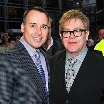 Sir Elton John and partner David Furnish became parents to baby boy Zachary