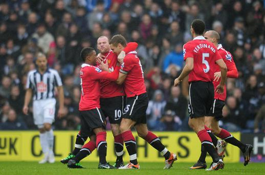Wayne Rooney of Manchester United celebrates with team-mates after scoring