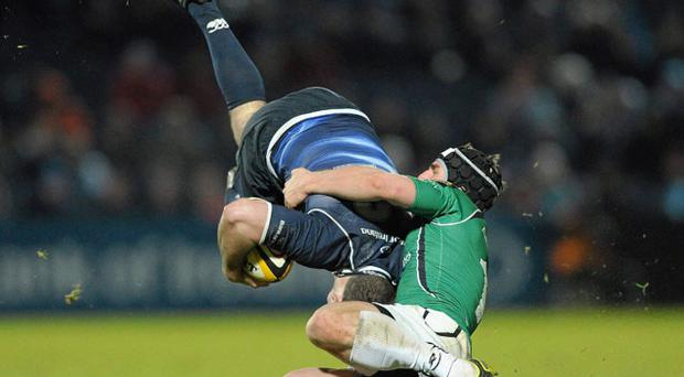 Leinster's Fergus McFadden is grounded by Ian Keatley of Connacht at the RDS. Photo: Sportsfile