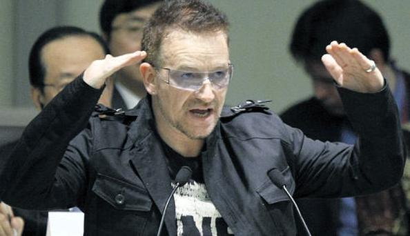 The U2 frontman is urged to lobby the EU for debt forgiveness.