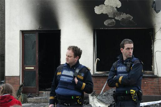 Gardai at the house in Cluain Ard, Ballybane, Co Galway, which was targeted by arsonists