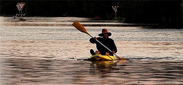 A man kayaks in floodwaters in Rockhampton, Queensland. Photo: Reuters