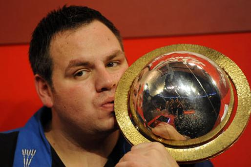 Adrian Lewis kisses the trophy after defeating Gary Anderson in a thrilling final. Photo: PA