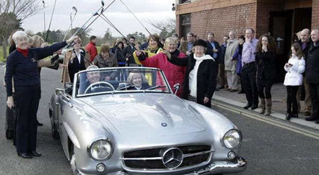 Captain Andy Collinge and Lady Captain Joan McPartlan arrive in style in a 1958 Mercedes 190SL for the Captains Drive-In at Beaverstown Golf Club. Photo: Steve Humphreys
