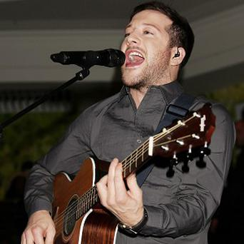 X Factor winner Matt Cardle's debut single is the UK's Number One for a third consecutive week