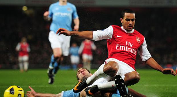 Pablo Zabaleta and Theo Walcott battle for possession during the stalemate at the Emirates Stadium last night. Photo: Getty Images