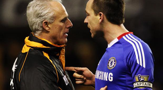 Mick McCarthy and John Terry exchange words last night. Photo: Getty Images