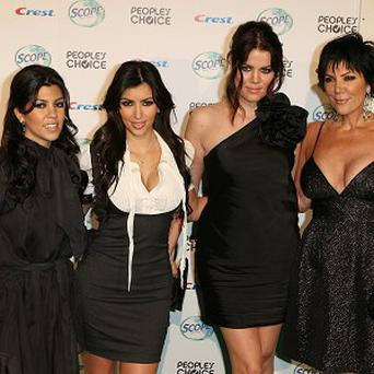 Khloe Kardashian, seen here with her sisters and mother Kris,will star in a new TV show