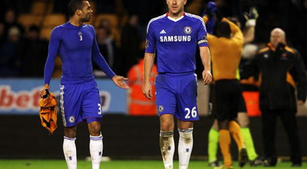 Chelsea duo Ashley Cole and John Terry cut a disconsolate pair as they leave the pitch after losing to Wolves on Wednesday night. Photo: Getty Images