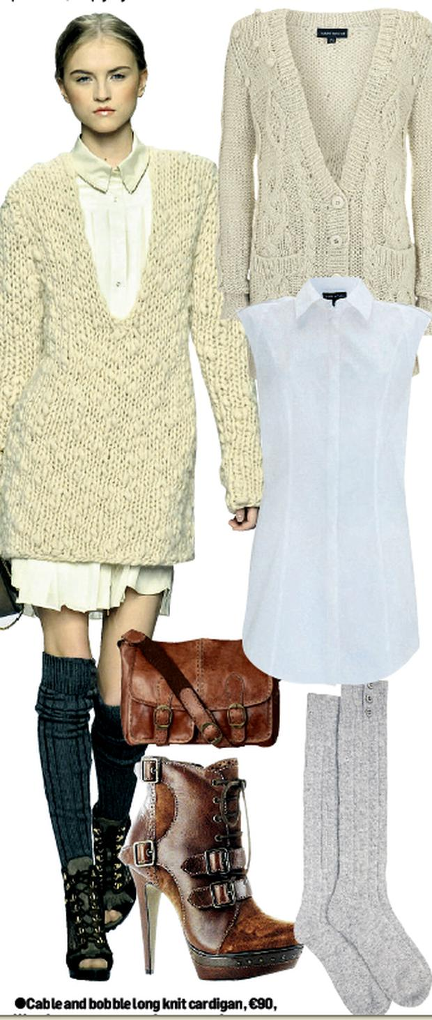 Cable and bobble long knit cardigan, €90, Warehouse; White cotton shirt dress, reduced from €35 to €20, Warehouse; Leather satchel bag, €56, Oasis; Brown hiking ankle boots, €134.50, River Island; Angora knee-high socks, €13, Marks & Spencer