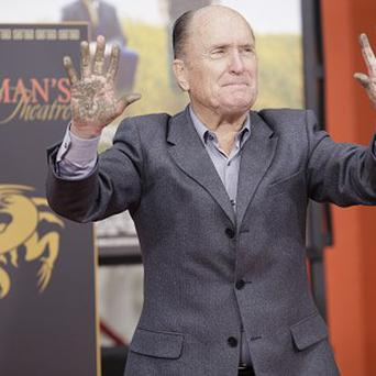 Robert Duvall sinks his hands into wet cement in Hollywood