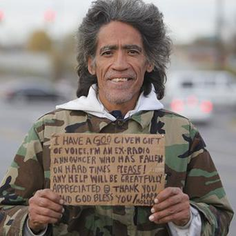 Ted Williams holds a sign advertising his smooth radio voice near a highway ramp in Ohio (AP)