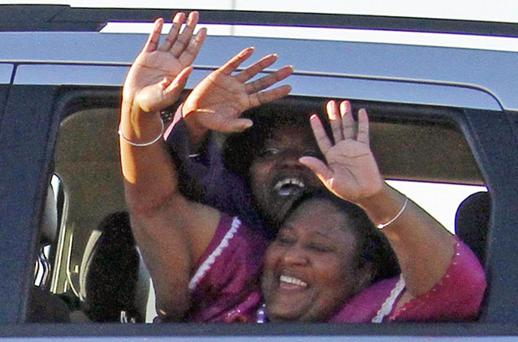 Jamie (front) and Gladys Scott wave as they leave prison. Photo: AP