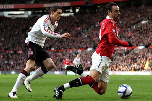 Dimitar Berbatov wins a penalty courtesy of Daniel Agger to give Ryan Giggs the chance to score the winner. Photo: Getty Images