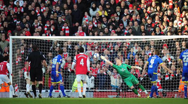 Leeds goalkeeper Kasper Schmeichel makes a spectacular injury-time save from Arsenal's Denilson to earn his side a replay on Saturday. Photo: Getty Images