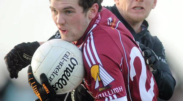 Conor Healy of Galway shakes off the attentions of Sligo's Paul McGovern in yesterday's FBD League clash at Enniscrone