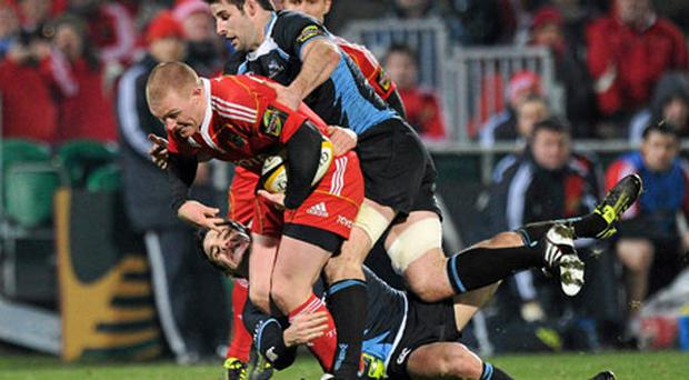 Munster's Keith Earls is tackled by Glasgow duo Johnnie Beattie and Max Evans on Saturday night. Photo: Matt Browne / Sportsfile