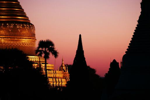 BAGAN, BURMA - JANUARY 18: The Golden Shwezigon Paya Pagoda in the sunset, Temple on Jan 18, 2007 in Bagan, Burma.Once the capital of the first Myanmar Kingdom, Bagan has about 4000 sacred stupas and buddhist monuments built between the 10th and 14th centuries AD. In 2002 Bagan was nominated as UNESCO World Heritage. (Photo by EyesWideOpen/Getty Images)