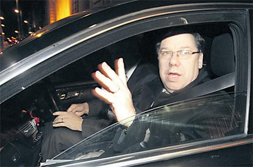 Taoiseach Brian Cowen leaving Government Buildings last night