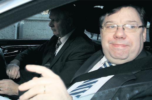 Taoiseach Brian Cowen arriving at Government Buildings in Dublin yesterday. Photo: Tom Burke