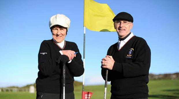 At the Howth Golf Club's Captains drive-in were Breda Mullalley (Lady Captain) and Bernard Byrne (Captain). Photo: Kenneth O Halloran