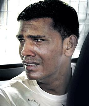 A tearful Abinash Treeboowoon at Mapou District Court in Mauritius where he was charged with Michaela's murder. Photo: Steve Humphreys