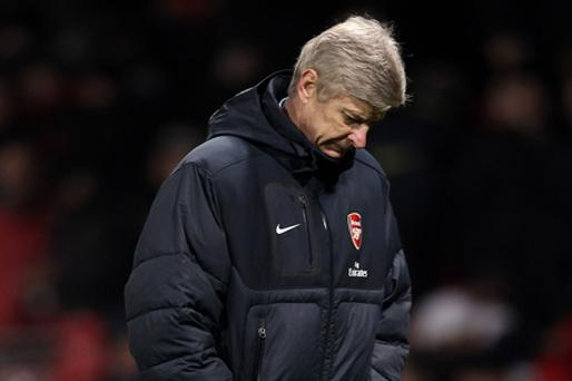 Feeling down: Arsene Wenger admitted he was 'disappointed' by Arsenal's defeat. Photo: Getty Images