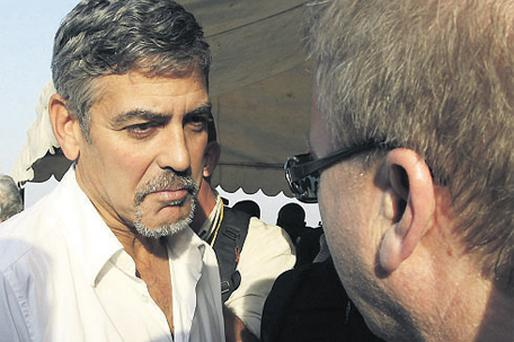 Actor George Clooney talks to a journalist in Juba this week during the south Sudan referendum