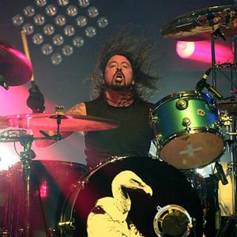 Foo Fighter and former Nirvana star Dave Grohl has been awarded the NME Godlike Genius Award