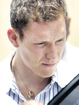 His face etched with grief and with Michaela's precious wedding rings on a chain around his neck, a devastated John McAreavey yesterday began the heartbreaking task of bringing her body home from Mauritius