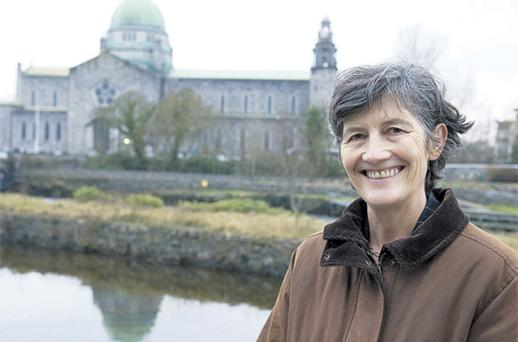 Galway city councillor Catherine Connolly, who will run as an independent, pictured on the banks of the River Corrib yesterday