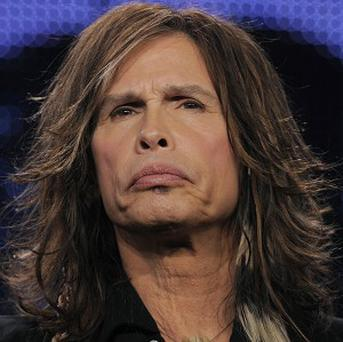 Steven Tyler says his new American Idol role won't stop him rocking out with Aerosmith