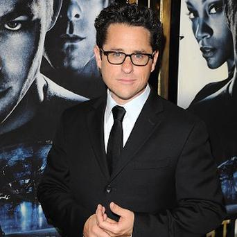 JJ Abrams is waiting to see a script before making a decision about the Star Trek sequel