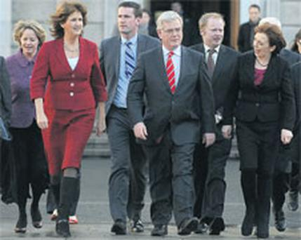 Labour leader Eamon Gilmore leads members of his parliamentary party on to the plinth at Leinster House yesterday to announce his tabling of a motion of no confidence. Photo: DAMIEN EAGERS