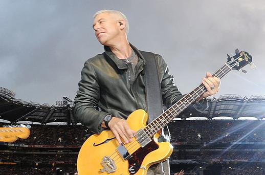 SETTLING DOWN: Adam Clayton slapping the bass with his bandmates at a U2 gig in Croke Park. Photo: Damien Eagers