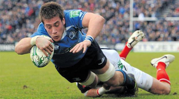 Leinster's Dominic Ryan dives over the line for his side's second try against Saracens in yesterday's Heineken Cup Pool 2 43-20 victory at The RDS. Photo: Brendan Moran