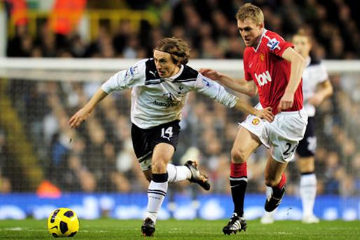 Luka Modric is pursued by Darren Fletcher during yesterday's match at White Hart Lane. Photo: Getty Images