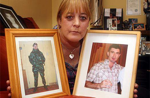 Tina O'Connor with pictures of her son Warren, left, in his army uniform and, right, one taken hours before he was stabbed to death