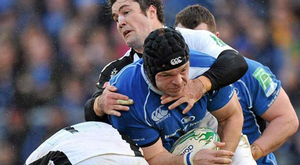Leinster's Mike Ross, here being tackled by Rhys Gill and Brad Barritt of Saracens at the RDS last Saturday, has won the support of many observers to get a call-up to Declan Kidney's international front-row. Photo: Brendan Moran / Sportsfile